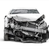 carcass of crashed car in front side, Car insurance concept
